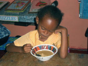 children-eating-jeffrey-town-jamaica